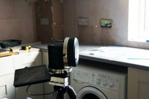 laser template tool set up in a kitchen to laser measure for quartz worktops