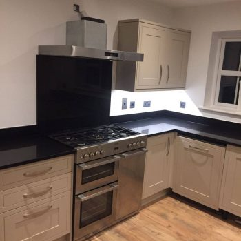 cosmico nero urban quartz fitted in a kitchen with upstands