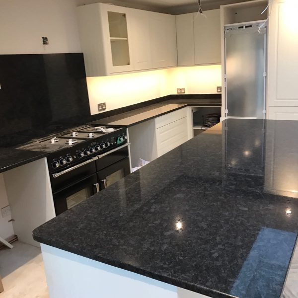 Grey Stone Kitchen Worktops : Grey Granite worktops and island piece. One of our favourite Granite ...