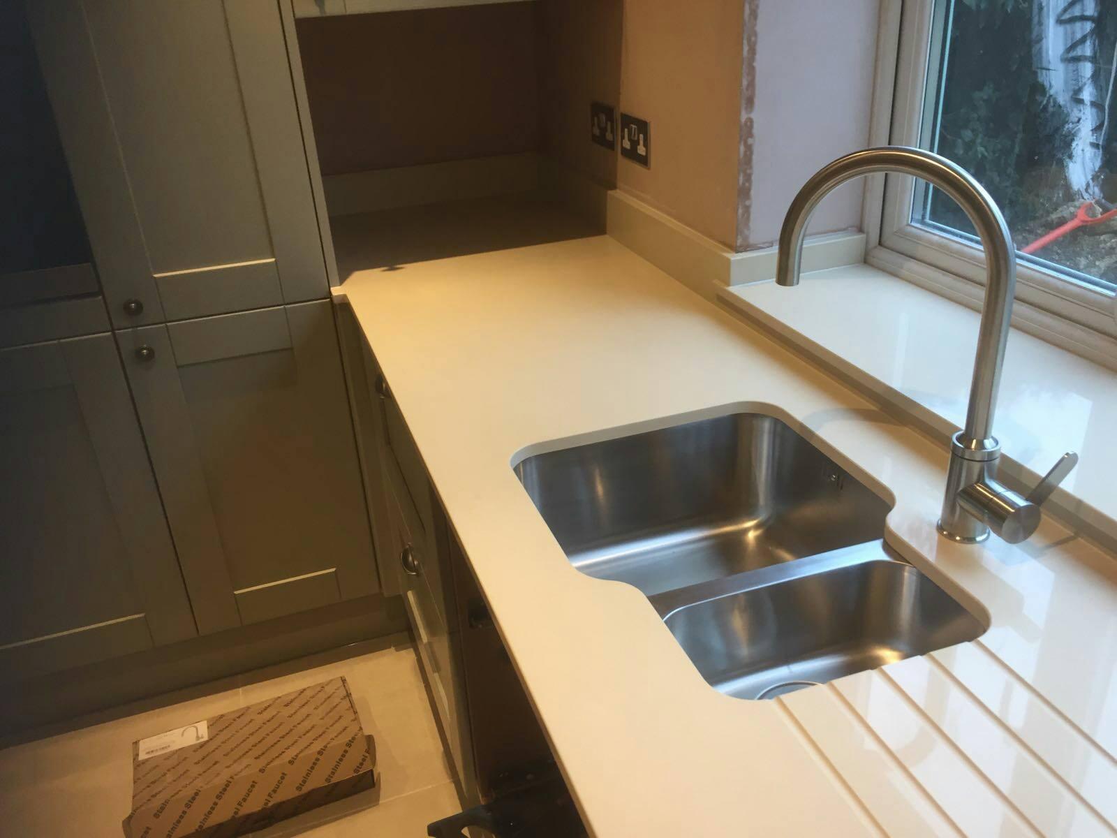 Kitchen sink with matching black glass tap landing and sliding cover - Bianco Marmo Suprema Urban Quartz Kitchen Worktops