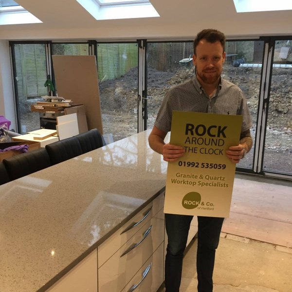 grigio medio stella installed with customer holding famous rock and co board
