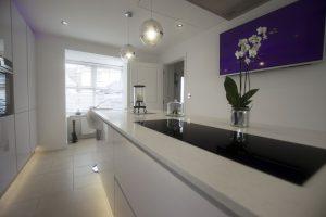 white quartz kitchen island showing black hob