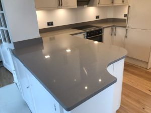 magnifico de lusso grey quartz worktops with high gloss white kitchen