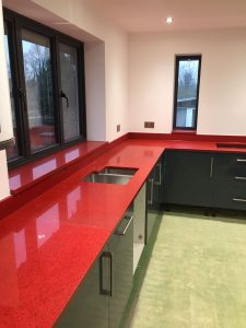 red starlight rosso stella urban quartz with grey glossy kitchen
