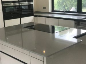 grigio chiaro pura quartz worktops in grey high gloss kitchen
