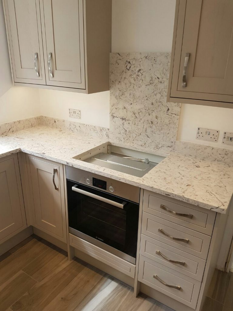 strapazzate urban quartz worktops in traditional cream kitchen