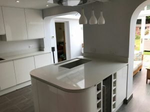 bianco de lusso quartz worktops in gloss white kitchen