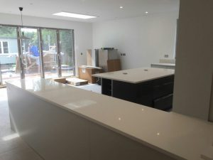 bianco minerale quartz worktops installed in large open plan kitchen