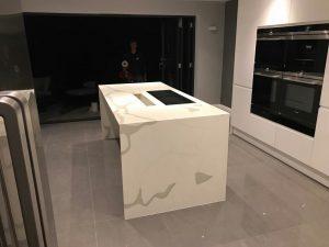 calacutta urban quartz in high gloss kitchen rockandco