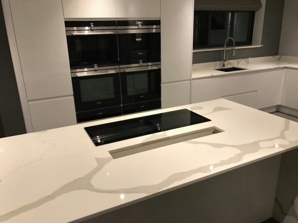 calacutta urban quartz in high gloss kitchen rockandco