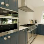 bianco puro pure white quartz worktops in blue traditional kitchen