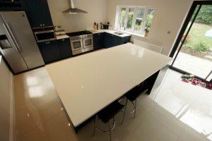 bianco puro pure white quartz worktops in blue traditional kitchen