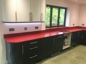 rosso stella red starlight quartz worktops in grey kitchen