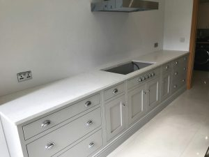 attica white carrera white quartz in kitchen with island