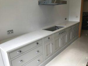 attica white carrera white quartz in kitchen with island