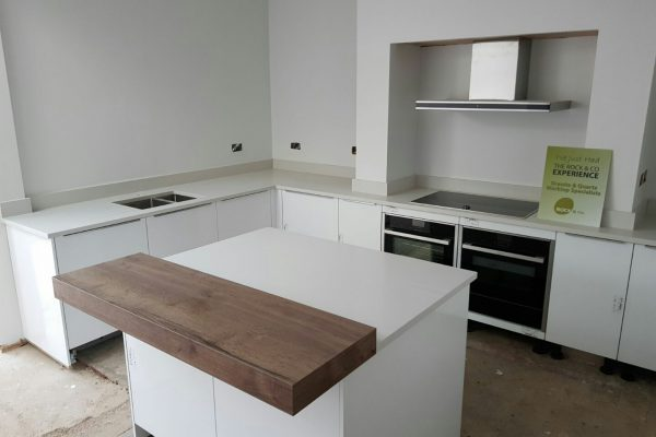 bianco de lusso quartz worktops with wooden breakfast bar