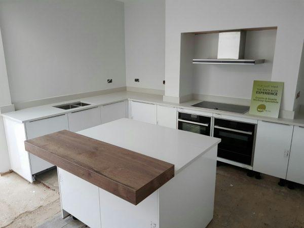 bianco de lusso quartz worktops with wooden breakfast bar