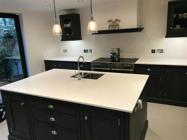 bianco puro white quartz worktops in traditional blue kitchen