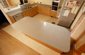 nebbia grigia quartz worktops installed in oak kitchen