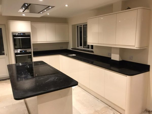 nero venata black quartz worktops in kitchen