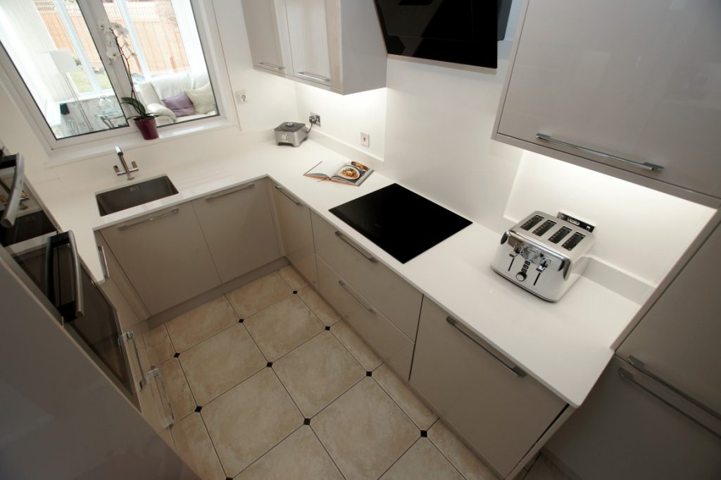 bianco puro pure white quartz worktops in taupe high gloss kitchen