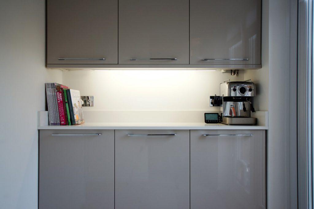 bianco puro pure white quartz worktops in taupe high gloss kitchen